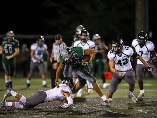 Palmetto Ridge High School's Adrian Gomez avoids a