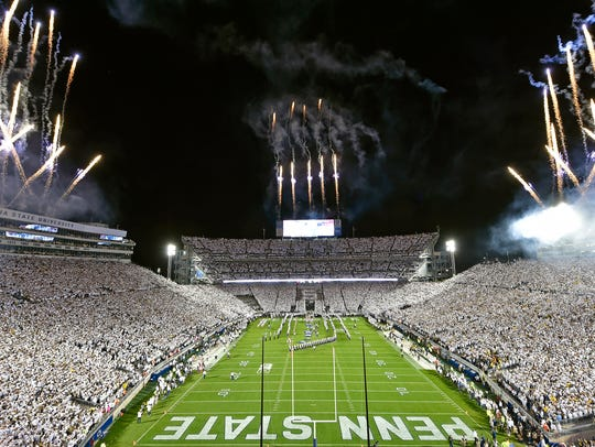 Fireworks are ignited for the opening of an NCAA Division