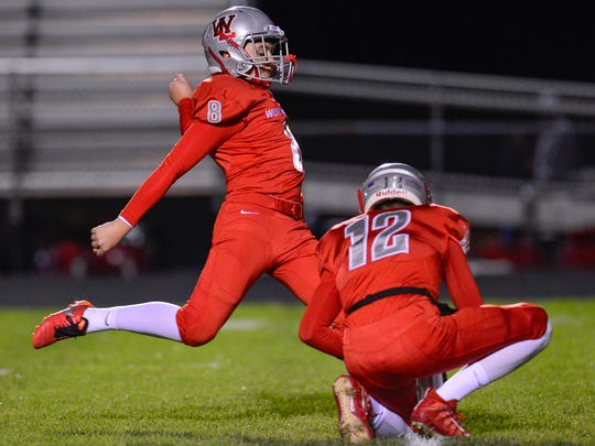 Kicker Caeb Krockover converts a PAT during a record-setting night.