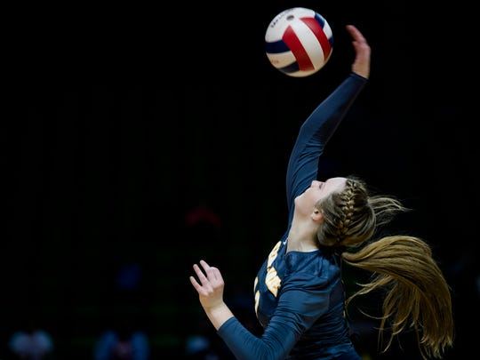St. James' Carson Ann Crow spikes the ball during the AHAA State Championship match between St. James and Deshler on Thursday, Nov. 2, 2017, in Birmingham, Ala.