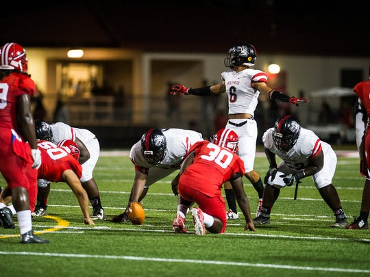South Fort Myers High School's Jeshaun Jones calls out a play during a game against Immokalee High School in Immokalee, Fla., on Friday, Nov. 3, 2017.