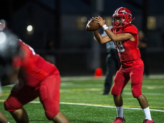 Immokalee High School's Rj Rosales looks to pass during