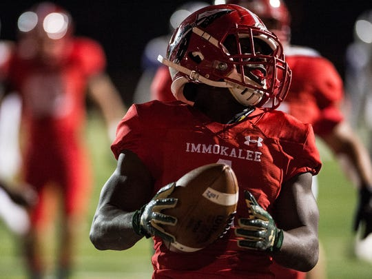 Immokalee High School's Fred Green takes the ball in for a touchdown during a game against Booker High School in Immokalee, Fla., on Friday, Nov. 10, 2017.