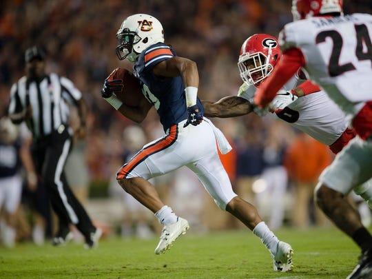 Auburn wide receiver Ryan Davis (23) runs for a touchdown during the NCAA football game between Auburn and Georgia on Saturday, Nov. 11, 2017, in Auburn, Ala.