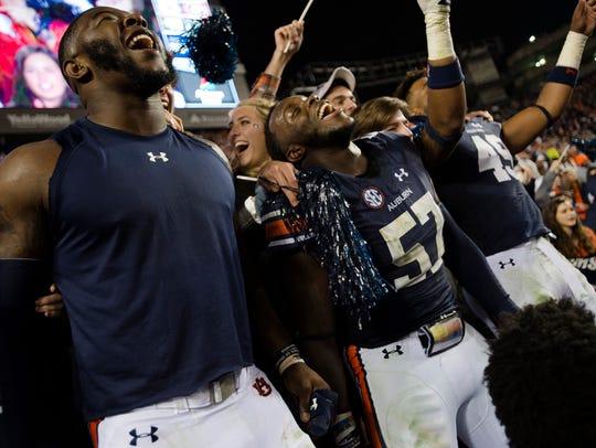 Auburn linebacker Deshaun Davis (57) celebrates with