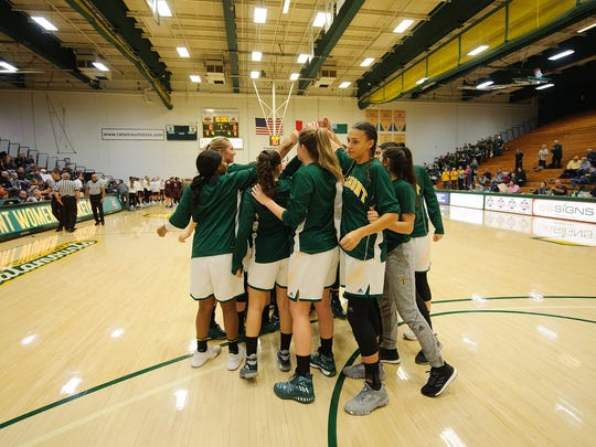Vermont huddles together before the start of the women's basketball game between the Norwich Cadets and the Vermont Catamounts at Patrick Gym on Wednesday night November 15, 2017 in Burlington.