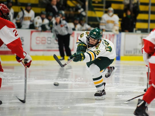 Catamount forward Eve-Audrey Picard (26) shoots the puck during the women's hockey game between the Boston Terriers and the Vermont Catamounts at Gutterson Fieldhouse on Friday night November 17, 2017 in Burlington.