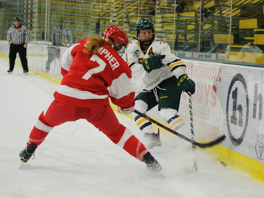 Catamounts defenseman Sammy Kolowrat (4) battles for