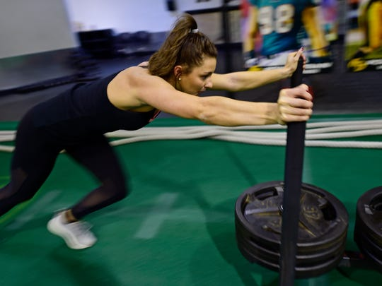 "Hannah Durbin, a senior at Elon University, works out at Power Train Mechanicsburg over her Thanksgiving Break. Durbin began battling anorexia in 2013, and says she's been fully recovered for a year and a half. She now uses her experience to inspire others through her ""Healthy Happy Hannah"" social media accounts and website."