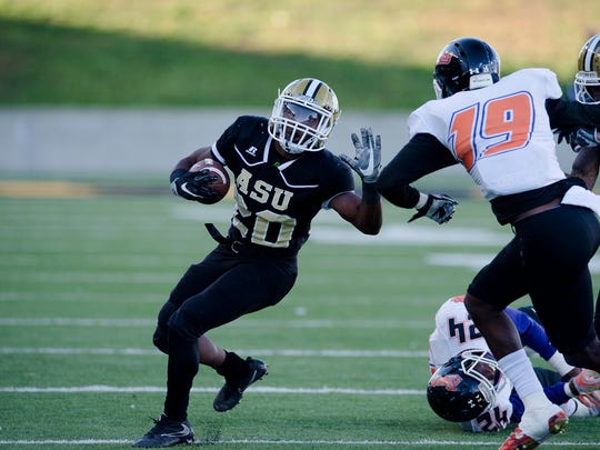 Alabama State running back Ezra Gray (20) runs downfield