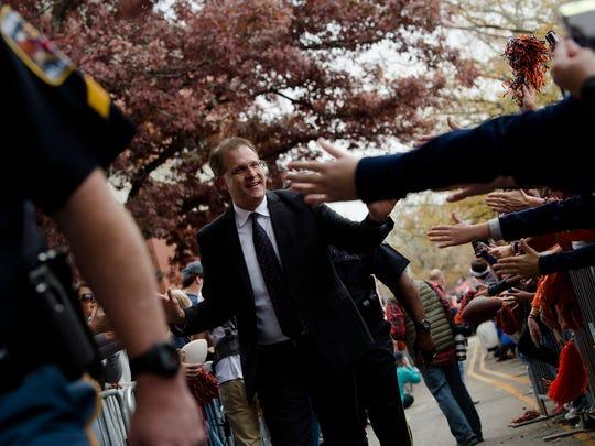 Auburn head coach Gus Malzahn greets fans during Tiger