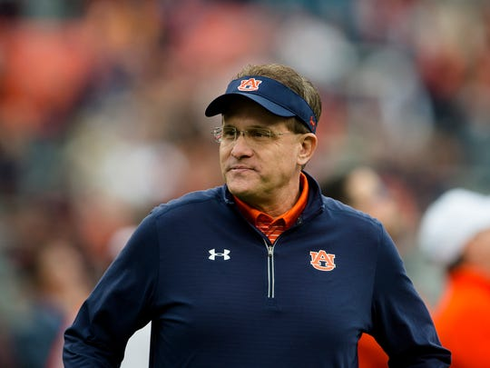 Auburn head coach Gus Malzahn walks the field before the Iron Bowl NCAA football game between Auburn and Alabama on Saturday, Nov. 25, 2017, in Auburn, Ala.