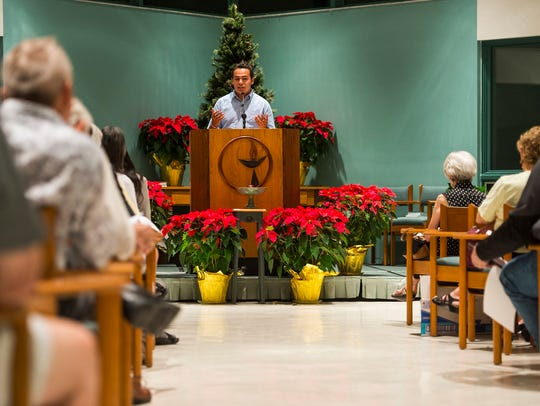 Bryan Oliva-Infante from FGCU speaks during a town hall meeting at the Unitarian Universalist Congregation of Greater Naples church in Golden Gate Estates, Fla., on Tuesday, Dec. 5, 2017. Collier County cooperation with federal immigration law enforcement was criticized by residents and speakers from the Florida ACLU, Collier NAACP, and Florida Immigrant Coalition.