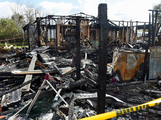The burned home of Gary Grimsley and DeLacy Bembry of Port St. Lucie is seen Dec. 6 on the 2100 block of Monterrey Lane in Port St. Lucie. Grimsley and Bembry, along with their two children, narrowly escaped the flames in the early morning hours of Dec. 4.