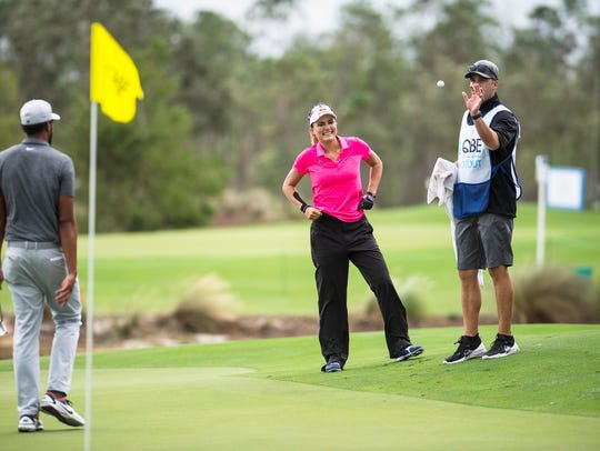 Lexi Thompson cracks a smile after finishing the 18th