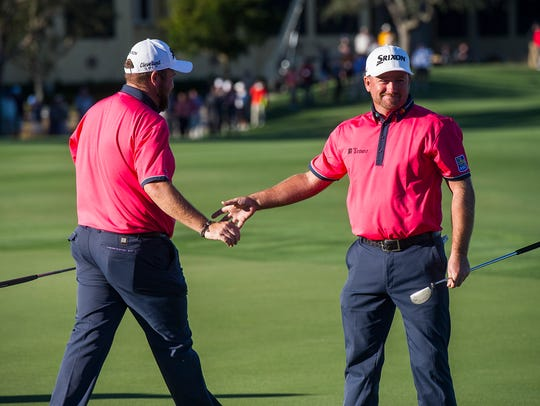 Shane Lowry gives a handshake to his teammate Graeme McDowell after the 18th hole during the final round of the QBE Shootout at Tiburón Golf Club in Naples on Sunday.