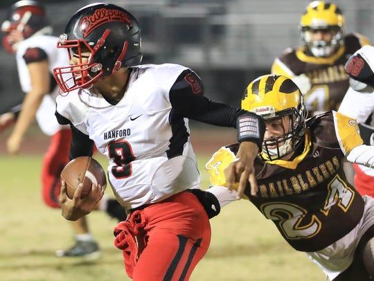 Golden West senior linebacker Josh Summers attempts