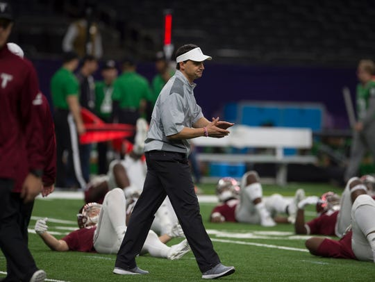 Troy head coach Neal Brown walks the field before the
