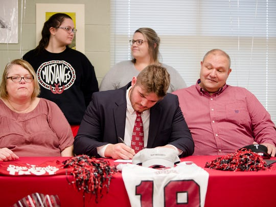 Jake Andrews signs commitment papers to Troy University for football on Wednesday, Dec. 20, 2017, at Stanhope Elmore High School in Millbrook, Ala.
