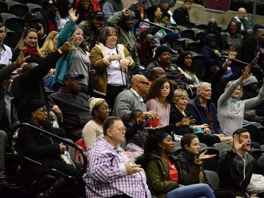 High School basketball fans fill the bleachers during