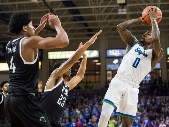 Florida Gulf Coast University's Brandon Goodwin jumps back for the fade-away shot during a game against USC Upstate at Alico Arena in Fort Myers, Fla., on Thursday, Jan 11, 2018.