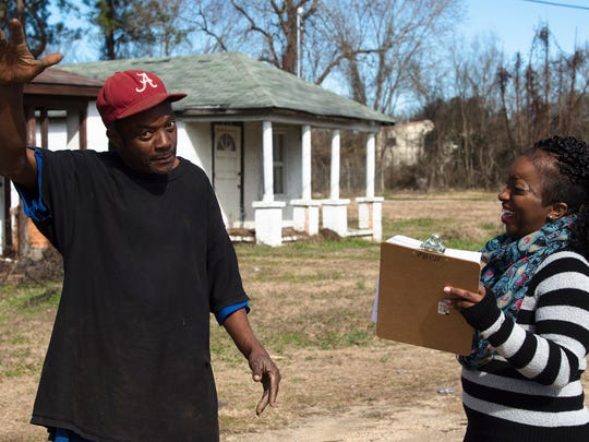 Richard Wright, a homeless man, speaks to Lakeesa Butler, Friendship Mission case manager, for her to fill out paperwork for for the Mid Alabama Coalition for the Homeless count of homeless on Wednesday, Jan. 24, 2018, in Montgomery, Ala.