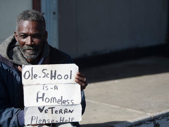 Cleve Savage holds up a sign giving information to Tammy Middleton, Friendship Mission executive director, so she can fill out paperwork for the Mid Alabama Coalition for the Homeless count of homeless on Wednesday, Jan. 24, 2018, in Montgomery, Ala.