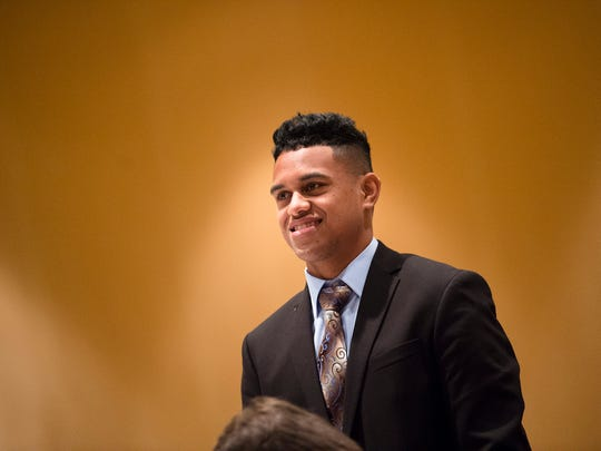 Thomson quarterback Taulia Tagovailoa  stands to be honored during the Alabama Sports Writers Association Mr. Football award ceremony on Tuesday, Jan. 30, 2018, in Montgomery, Ala.
