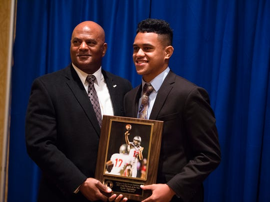 Thomson quarterback Taulia Tagovailoa  receives the AHSAA Class 7A Back of the Year during the Alabama Sports Writers Association Mr. Football award ceremony on Tuesday, Jan. 30, 2018, in Montgomery, Ala.
