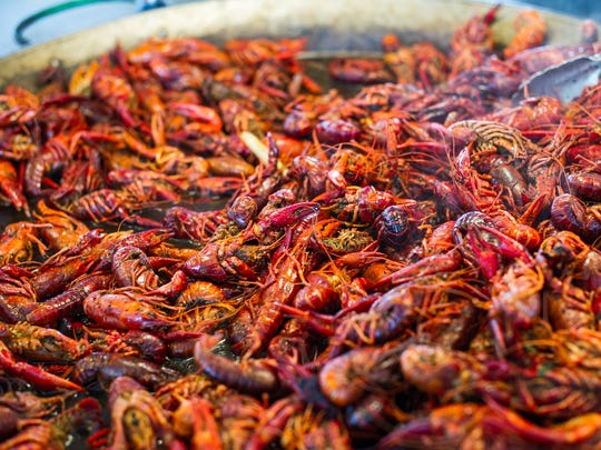 A pot full of crawfish steams during the Everglades