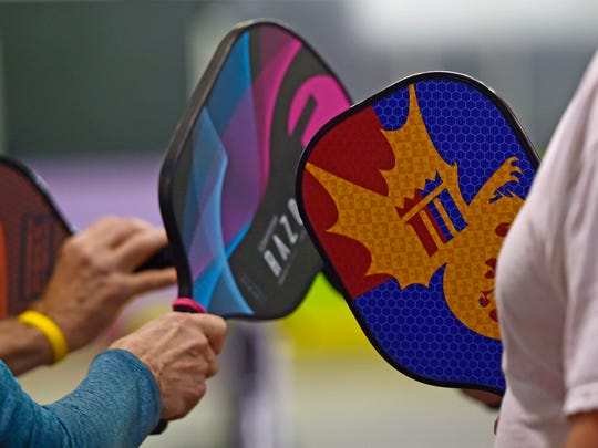 A group touches paddles after finishing a pickleball game at the Roll 'R' Way in York on Tuesday, Feb. 13. The White Rose Pickleball Association plays the game seven days a week. As of Feb. 7, 2018, the group had over 100 members.