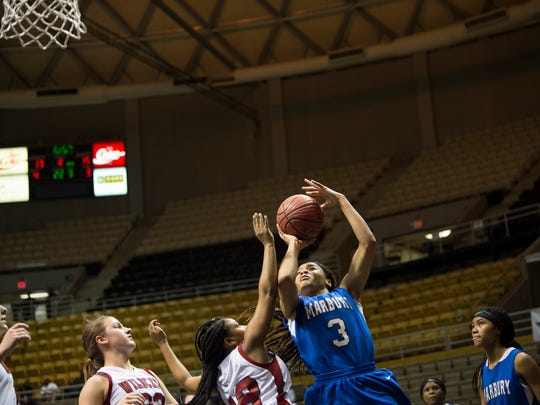 Marbury's Artisa Cannon shoots over Shelby County's Havlyn Mallory during the AHSAA 5A Regional Semi-Final game on Friday, Feb. 16, 2018, in Montgomery, Ala.