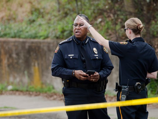 Montgomery Police Chief Ernest Finley speaks to Captain Regina Duckett as Montgomery Police respond to a shooting scene on Wednesday, Feb. 21, 2018, in Montgomery, Ala. Montgomery Police said an officer was shot with non-life threatening injuries and a potential suspect was killed.