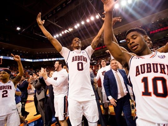 Auburn Tigers forward Horace Spencer (0) celebrates with his team after the NCAA basketball game on Wednesday, Feb. 21, 2018, in Auburn, Ala. Auburn Tigers defeated Alabama Crimson Tide 90-71.