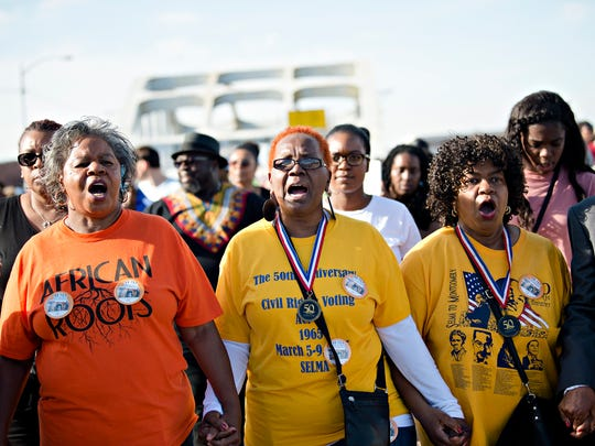 Foot soldiers, From right, Ruth Anthony, Helen Brooks, and Marcia McMilan Edwards, lead the march across the Edmund Pettus Bridge during the Bridge Crossing Jubilee in commemoration of the 53rd anniversary of Bloody Sunday on Sunday, March 4, 2018, in Selma, Ala.