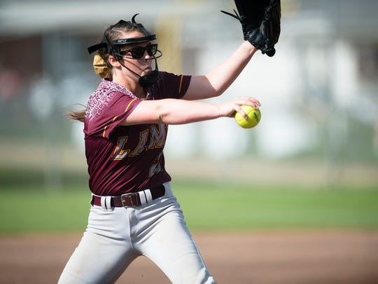 LAMP's Taylor Cassidy pitches during the game between