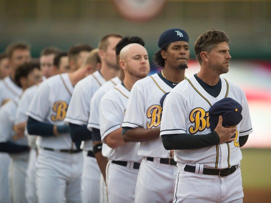 Biscuits manager Brady Williams puts his hat to his heart during the National Anthem during the Montgomery Biscuits season home opener against the Biloxi Shuckers on Thursday, April 5, 2018.