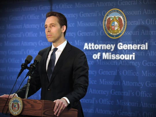 Missouri Attorney General Josh Hawley announces during a Tuesday, April 17, 2018, press conference in his Jefferson City, Mo., office that he has found evidence that Gov. Eric Greitens committed a crime. Hawley said it will be up to the St. Louis prosecutor to decide whether to charge Greitens. (Julie Smith/The Jefferson City News-Tribune via AP)