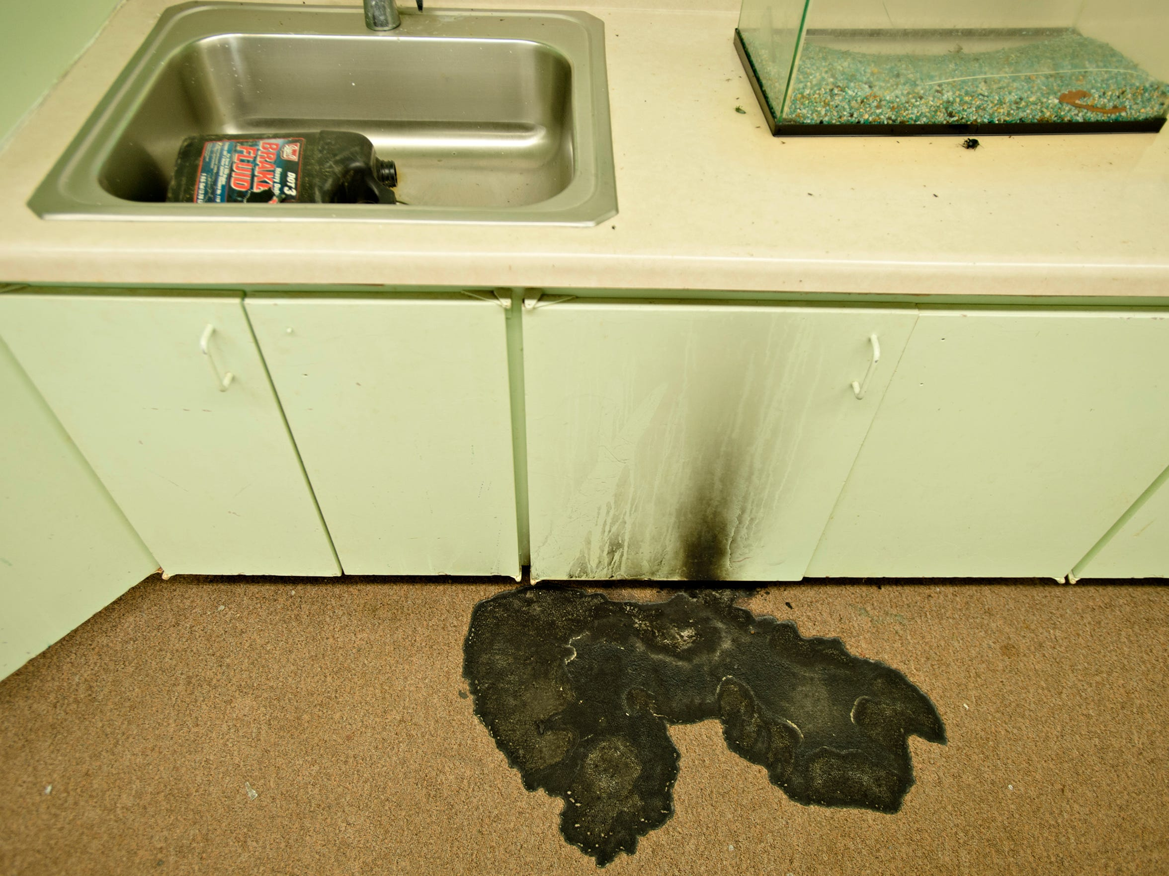 Burned carpet from an arson attempt from mid-summer