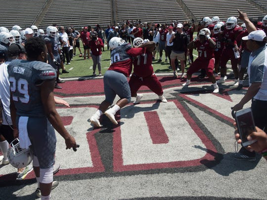 Troy defensive tackle Trevon Sanders (90) competes with Troy offensive lineman Travius Harris (77) during the Troy T-Day game on Saturday, April 21, 2018, in Troy, Ala.