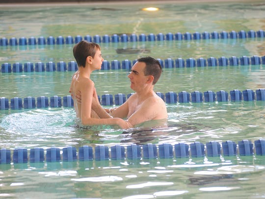 Alan Stokes and his son Jonathan enjoy the pool at