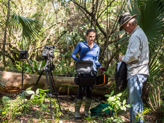 Bobbie Lee Davenport and Jay Staton put away come camera gear after filming on the property of the late conservationist Bob Gore in Golden Gate Estates on Sunday, Feb. 26, 2017. Collier County commissioners voted last week to buy the property with funds from the Conservation Collier trust.