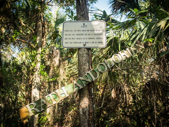 A sign hangs on a pole on the property of the late conservationist Bob Gore in Golden Gate Estates on Sunday, Feb. 26, 2017. Collier County commissioners voted last week to buy the property with funds from the Conservation Collier trust.