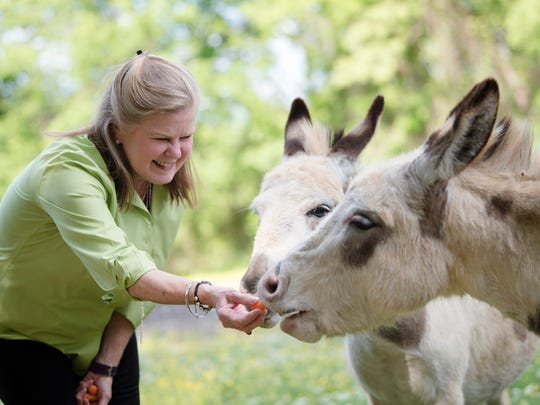 Sue Bell Cobb, former Alabama Supreme Court Chief Justice and current Democratic candidate for Alabama Governor, feeds her donkeys at her home in Pike Road, Ala., on Wednesday, May 2, 2018.