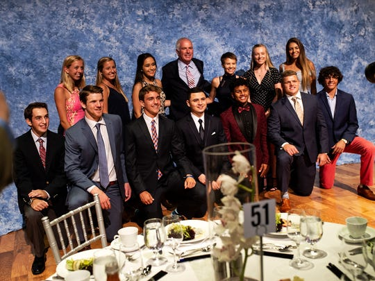 Curtis Strange poses with Winged Foot Scholar-Athlete Award finalists during a banquet at Artis-Naples in Naples, Fla., on Thursday, May 24, 2018. The Winged Foot Scholar-Athlete Foundation will give $5,000 to each of its finalists. The winner receives a $10,000 scholarship — $2,500 a year for four years; the other finalists receive one-time stipends.