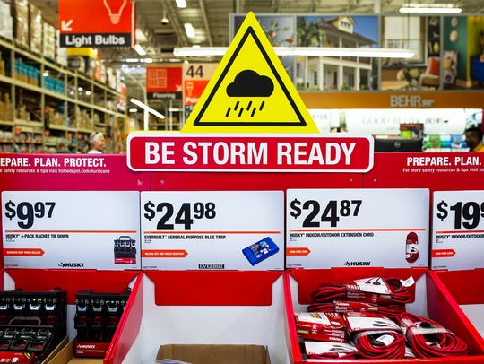 Hurricane prep supplies sit out on display during a
