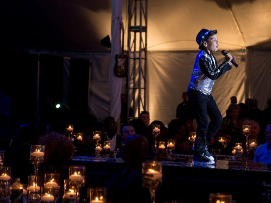 """Jason Kolbusz, 10, of Detroit performs the Jackson 5's  """"I Want You Back""""  during a musical tribute to the Jacksons at a gala outside Music Hall in Detroit on Friday, June 15, 2018. The event was part of the festivities surrounding Detroit Music Weekend."""