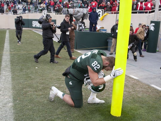MSU senior tight end Josiah Price takes a moment after