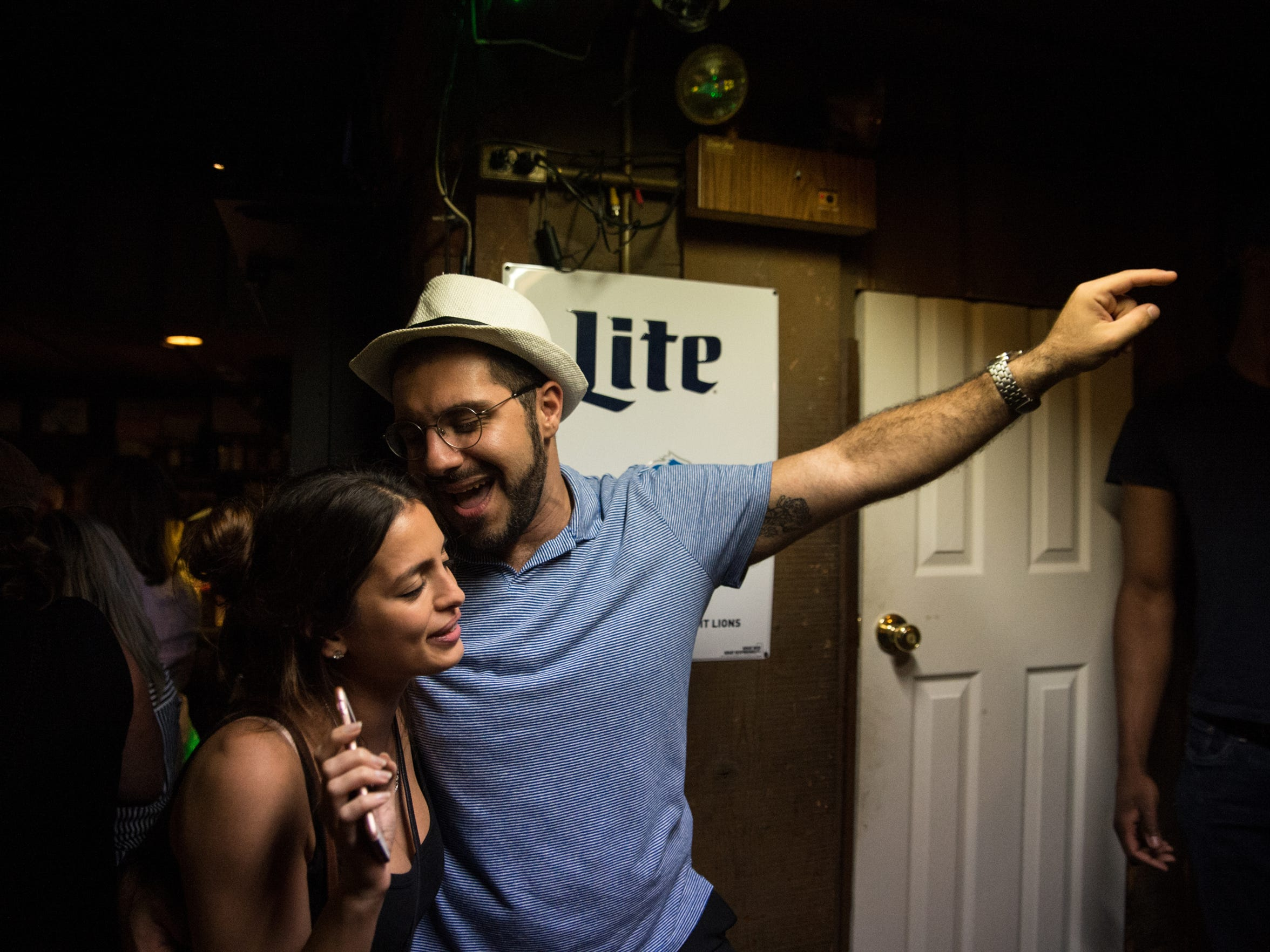 Yafa Davydova of Royal Oak and Nadeem Kandalaft of Royal Oak sing along to karaoke at Sneakers' Pub in Ferndale, Mich. on Friday, July 20, 2018.