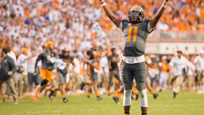 Tennessee quarterback Joshua Dobbs raises his arms in victory after defeating Florida for the first time in 11 seasons in 2016.